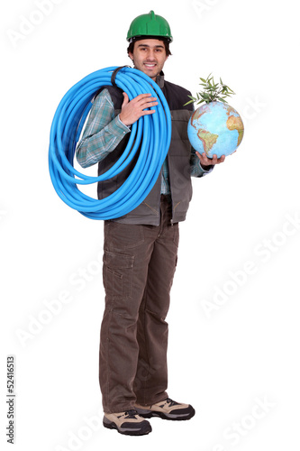 craftsman holding a hose and a globe with a green plant on it