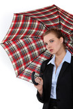 Young woman in suit with an umbrella