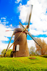 Traditional Old dutch windmill in Holland with blue sky