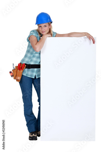Female worker with a blank board