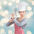 "Woman in chef's hat ""firing a gun"" with the mixer"