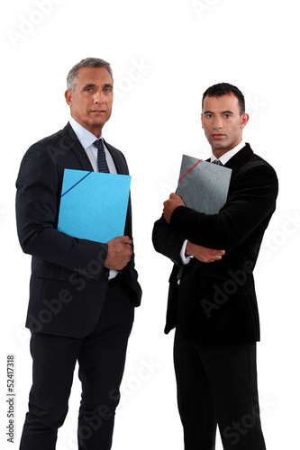 two businessmen holding folders
