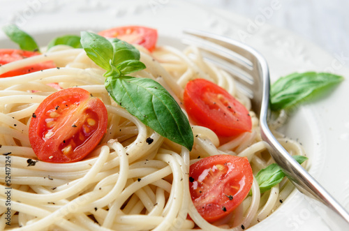 Simple pasta meal with tomatoes and greens