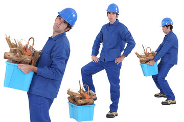 construction worker carrying recyclable material