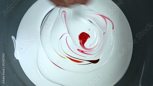 painter mixes red and white paint