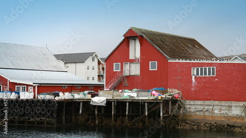 Red wooden houses and packed fishing nets