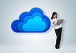 Cloud computing idea concept. Businesswoman stands by the cloud