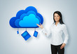 Cloud computing idea concept. Businesswoman points to the cloud