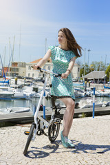 Fashion beautiful woman have fun with bike