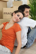 Couple relaxing after moving house