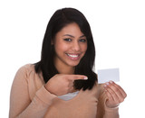 Young Woman Pointing At Visiting Card
