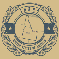 Grunge rubber stamp with name and map of Idaho, USA, vector
