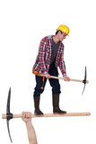 Laborer with pick axe
