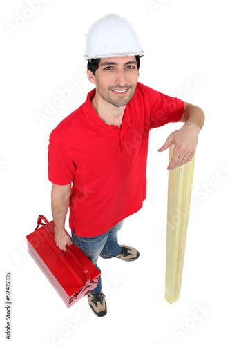 Man holding tool-box and wooden planks