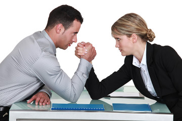 arm wrestling between male and female colleagues