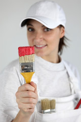 Painter with a paintbrush in her hand