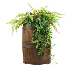 Composition of artificial flowers in old wooden barrel isolated