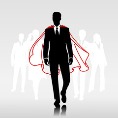 Businessman team hero with red cloak in front of his team