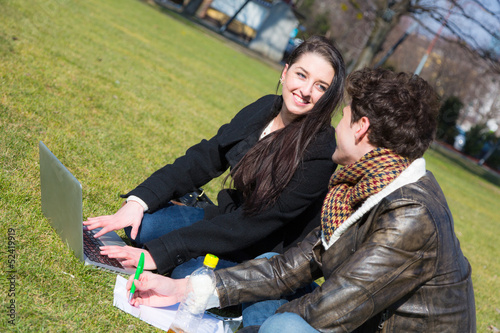 Young Couple with Computer at Park in Wien