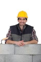 portrait of handsome bricklayer