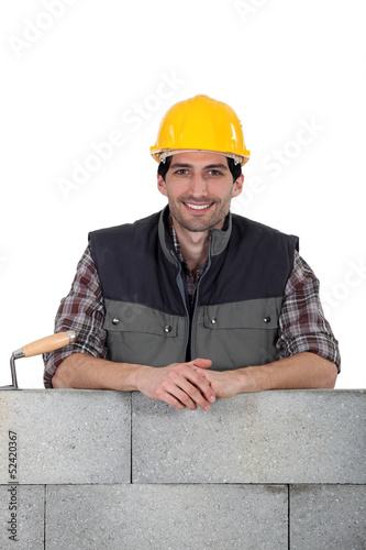 portrait of handsome bricklayer