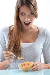 Woman eating breakfast cereal