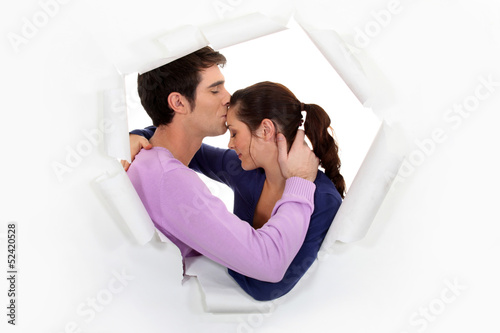 Man kissing girlfriend on forehead