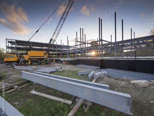 Staande foto Industrial geb. Building construction site at sunset