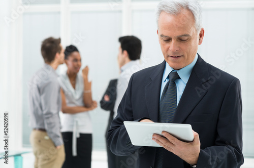 Businessman Working On Digital Tablet