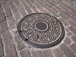 Manhole cover on old  street