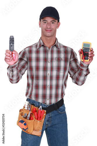 Man holding wire clipper and electrical current measure