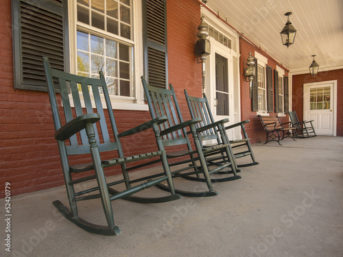 Rocking chairs on historic New England house