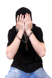 Man in Handcuffs Hide his Face