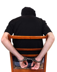 Man in Handcuffs on the Chair