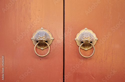 Chinese traditional door with lion knocker, Phuket Thailand.