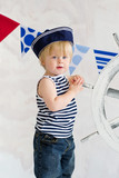 Cute little sailor boy posing