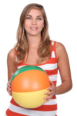 Woman holding an inflatable ballon.