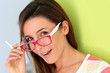 Portrait of funny girl with pink eyeglasses on