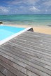Beautiful view of infinity pool with wooden deck