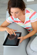 Young woman websurfing on internet with tablet