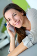 Cheerful brunette girl talking on mobile phone