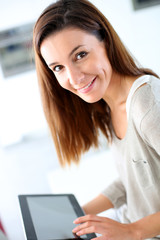 Young woman using electronic tablet