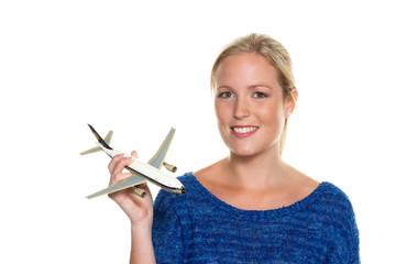 Frau mit Modellflugzeug