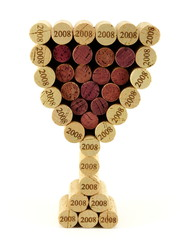 Corks in shape of wine glass filled with red stained corks