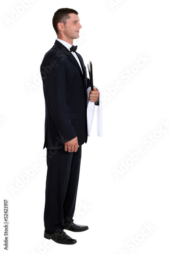 Profile view of male waiter