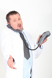 Doctor offering to shake hand whilst on the telephone
