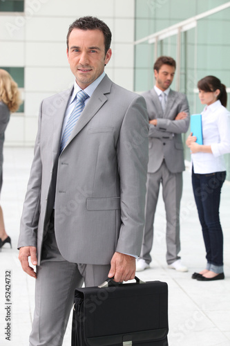 Man with briefcase outside office building