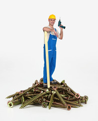 Worker standing on a pile of screws