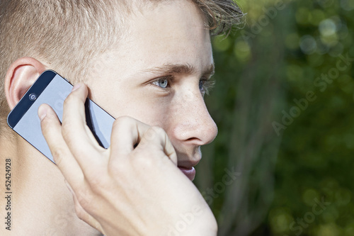 Young man talking in smartphone