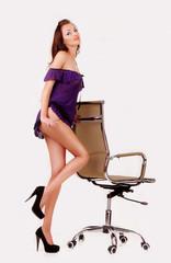 девушка в белье возле офисного кресла